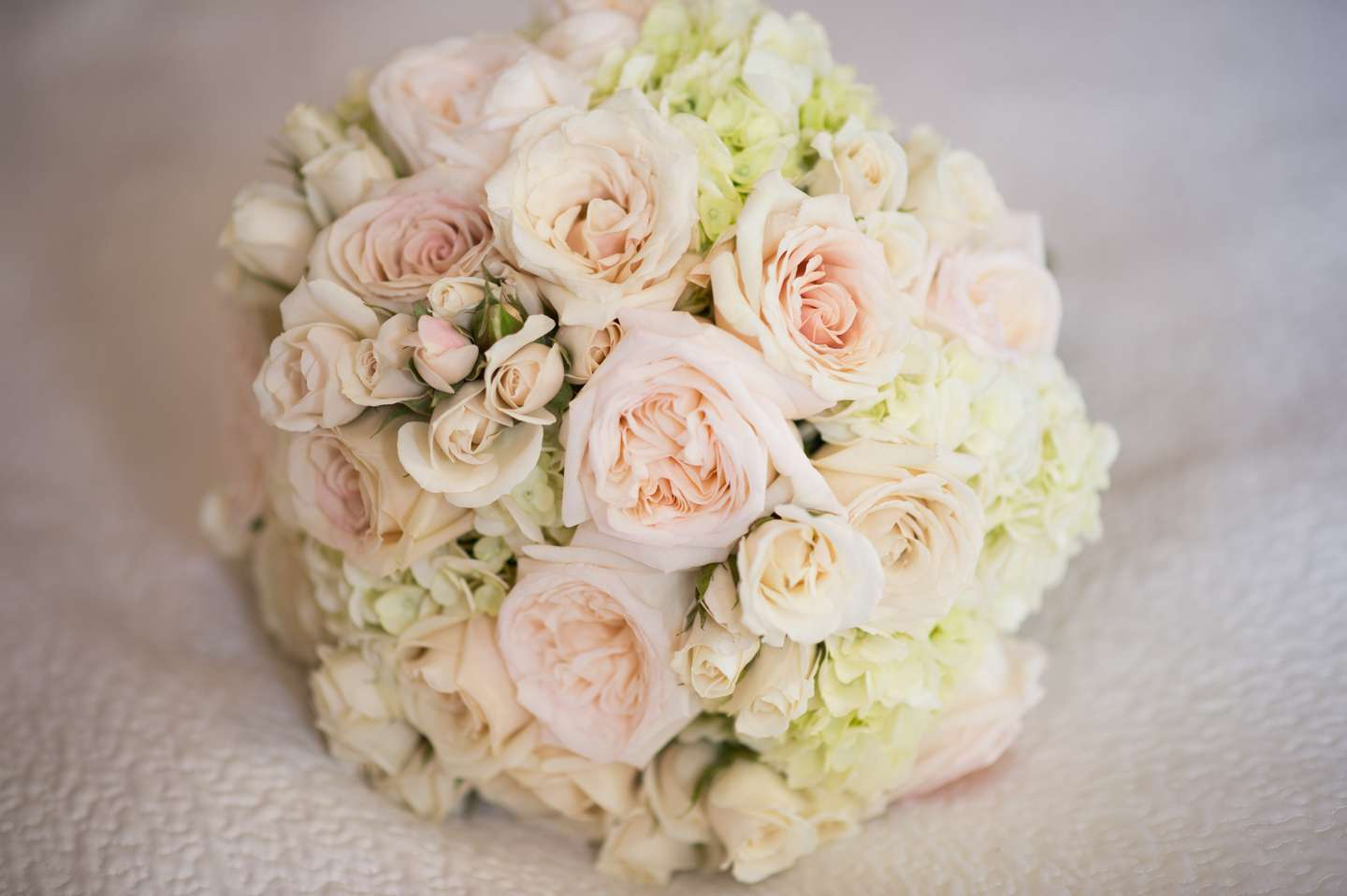 St. Augustine Wedding Planner coordinates Casa Monica Hotel wedding in downtown. Pink and White Bridal Bouquet