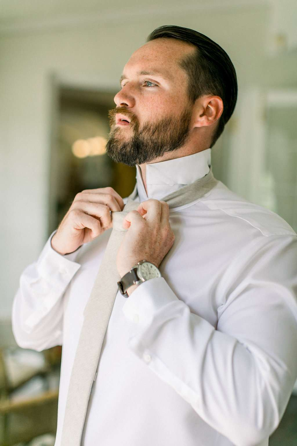 Groom getting ready at Ribault Club wedding