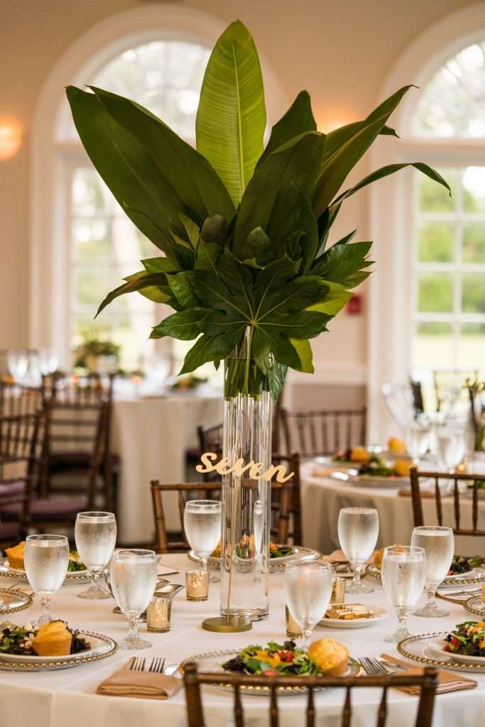 Tall tropical centerpieces at Ribault Club wedding