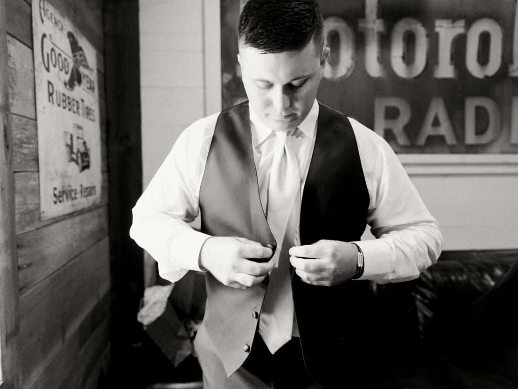 Groom getting ready details at Chandler Oaks barn