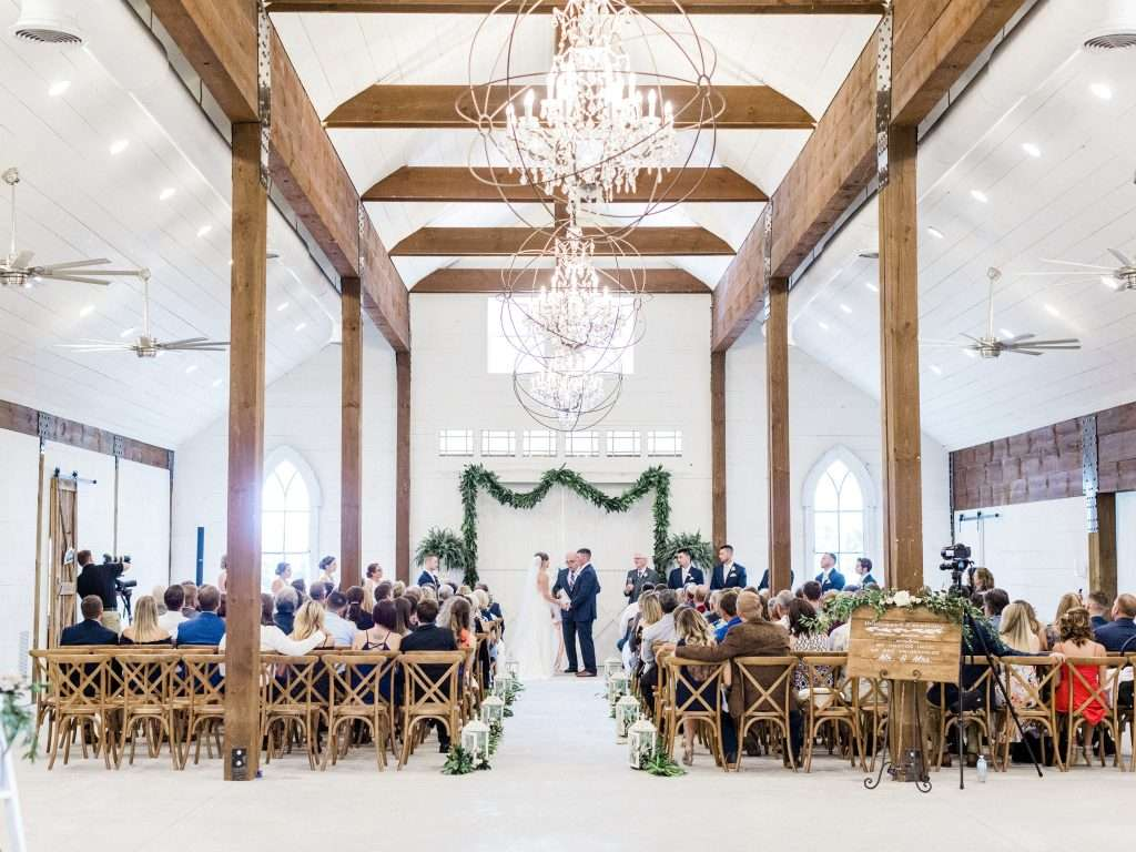 Indoor ceremony at Chandler oaks barn