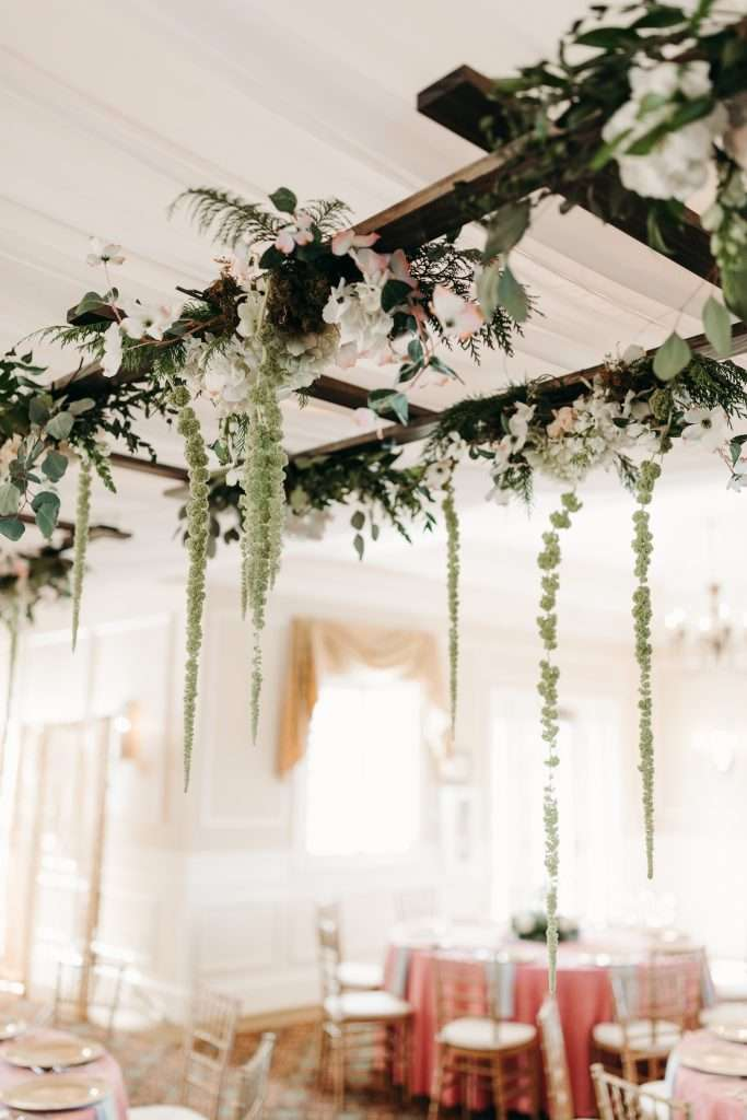 Hanging floral ladder at Riverhouse wedding
