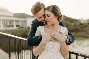Bride and Groom portraits at RIverhouse wedding on dock