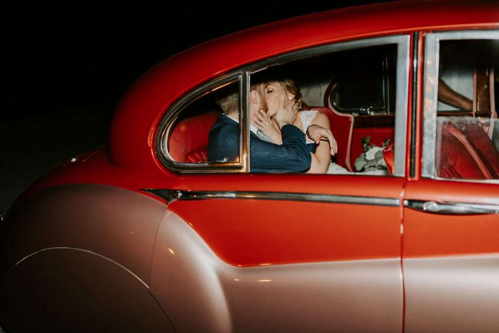Classic getaway car antique at Riverhouse wedding