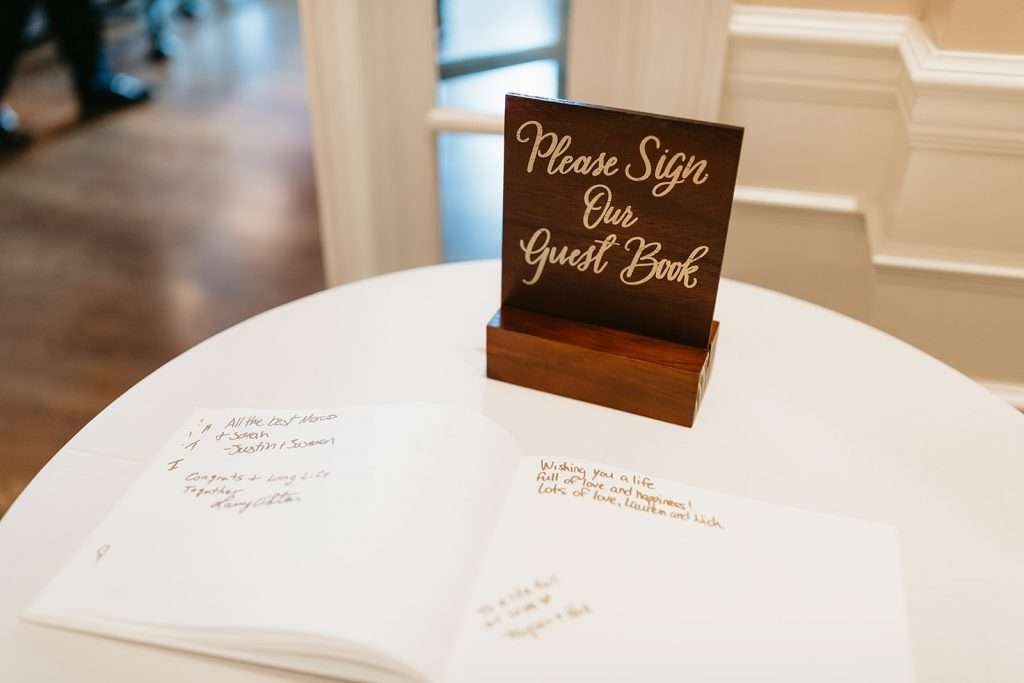 Guest book at River House wedding