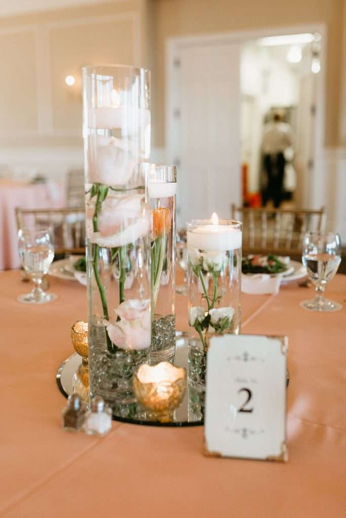 Candle centerpieces at River House wedding