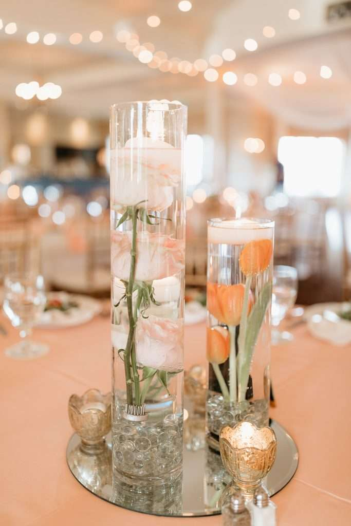Florals in candles for centerpieces at River House wedding