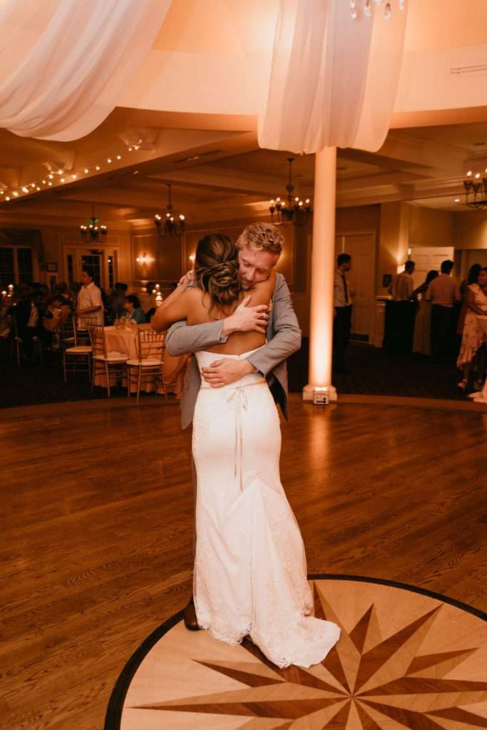 Bride dances with brother at River House wedding