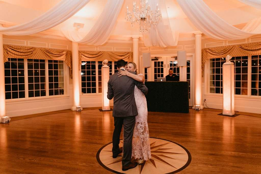Groom dances with mother at River House wedding