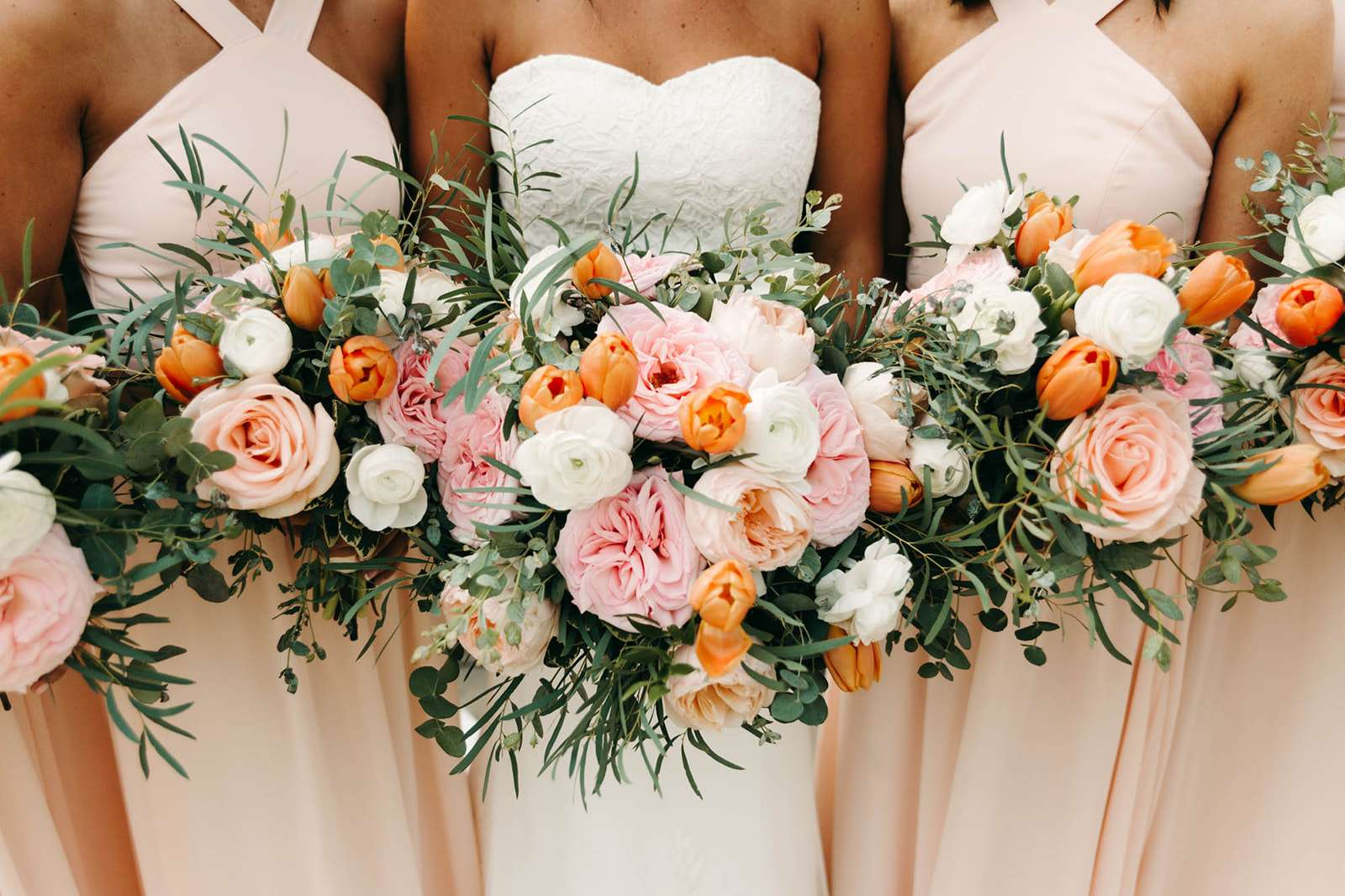 Bridesmaids bouquets at River House wedding